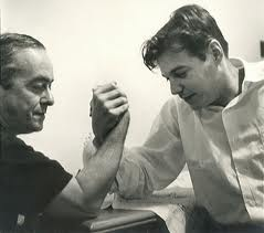 Vinicius de Moraes (l.) and Tom Jobim (r.) arm wrestling